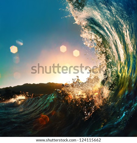 nice colored ocean wave falling down at sunset time - stock photo