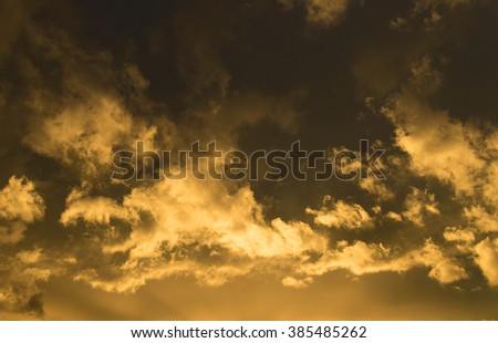 nice copper colored clouds during sunset - stock photo