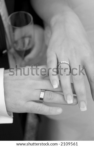 Nice couple and their rings at their party - stock photo
