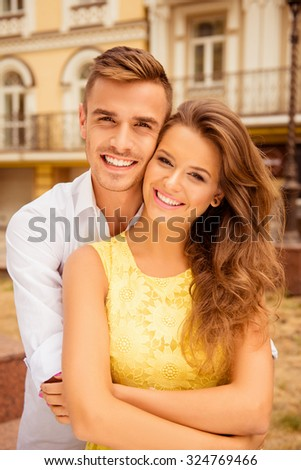 Nice couple in love on the background of buildings - stock photo