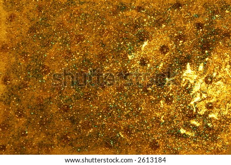 Nice dark golden abstract background. Different bright colors and glitter. - stock photo