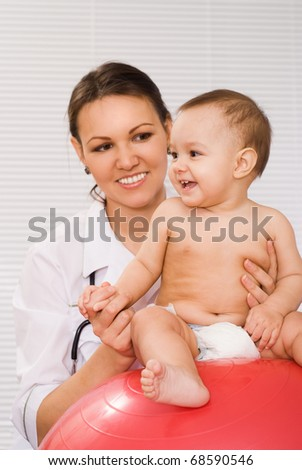 nice doctor with newborn on a white background - stock photo