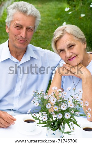 nice elderly couple in a summer park