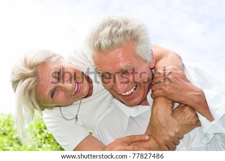 nice elderly couple together in a summer park - stock photo