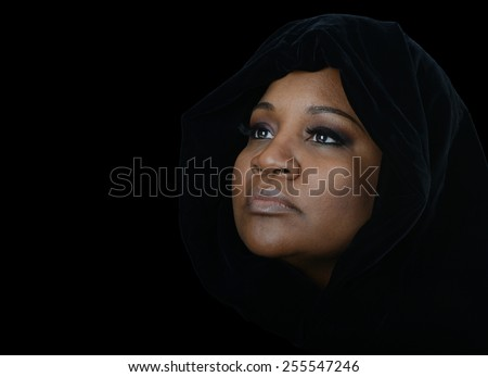 Nice emotional Image of a afro american muslim woman - stock photo