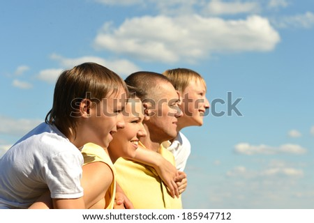 Nice family of four on sky background