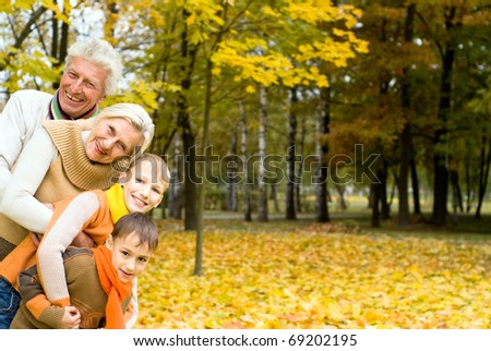 nice family of four on the nature - stock photo