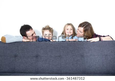 Nice family sit on the livingroom sofa - stock photo