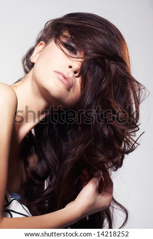 Nice fashion girl posing on light background - stock photo