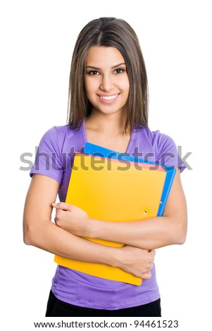 Nice female student smiling and looking at camera - stock photo