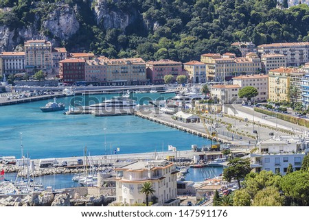 NICE, FRANCE - AUG 28: Aerial view of the old harbor Lympia and the city architecture on August 28, 2012 in Nice, Cote d'Azur, France. Port was built in 1745.