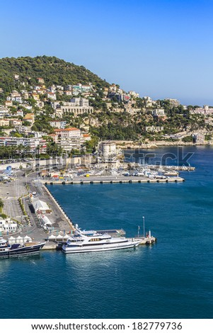 NICE, FRANCE - AUGUST 28, 2012: Aerial view of the old harbor Lympia and the city architecture. Port was built in 1745. Cote d'Azur, France.