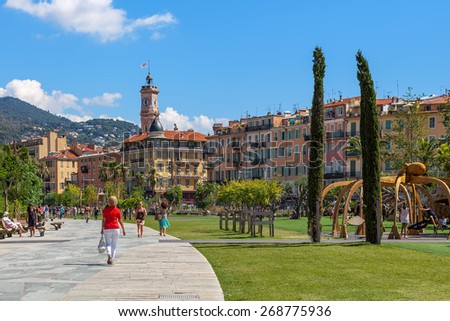 NICE, FRANCE - AUGUST 23, 2014: People at Promenade du Paillon - 12 hectares, 1.2km long new green pedestrian walkway area in the heart of Nice opened on October 26, 2013. - stock photo