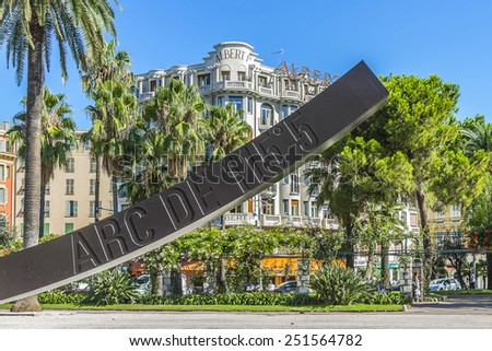 NICE, FRANCE - AUGUST 29, 2012: View of Arc de 115.5 Degrees by Bernar Venet (1988), located in Albert I Gardens next to famous Massena Place. Alpes Maritimes, Provence, Cote d'Azur, French Riviera. - stock photo
