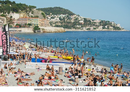 NICE, FRANCE - JULY 27, 2009: Unidentified people relax at the public beach in Nice, France.