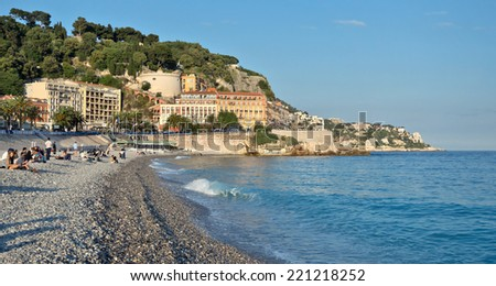 NICE, FRANCE - MAY 31, 2014: Beach Angel bay in Nice, France. Citizens and tourists sunbathing enjoying a sunny day on the beach.