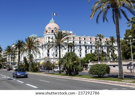 NICE, FRANCE - MAY 24, 2014: The Hotel Negresco, first opened in 1913 facing the Mediterranean sea, famous and luxury hotel offers 96 rooms and 21 suites - stock photo