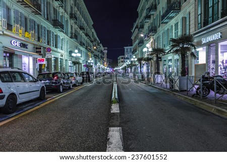NICE, FRANCE - NOVEMBER 5, 2014: Street in Old Town of Nice, France with sidewalk cafes, souvenir shops - stock photo