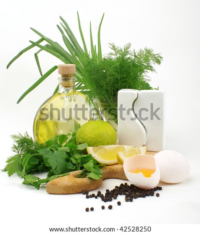 nice fresh herbs, leek, lemon, lime, spices, oil and eggs isolated on white background - stock photo