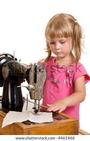 nice girl at old sewing machine