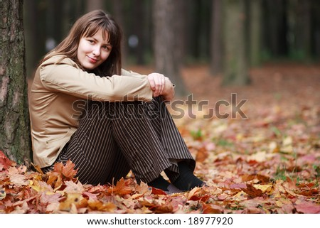 Nice girl at the autumn park