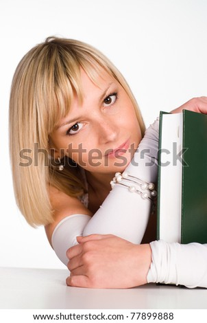 nice girl holding a book at the table