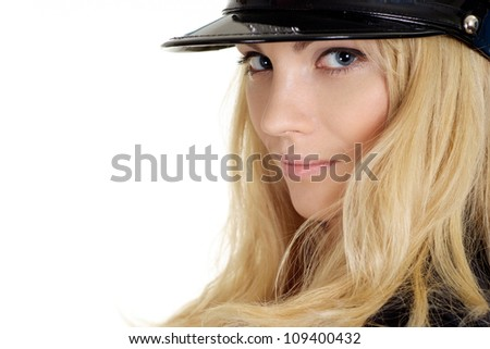 Nice girl in a uniform of  police officer on a white background - stock photo
