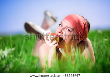 Nice girl in kerchief with apple - stock photo