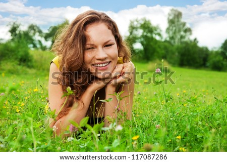 nice girl laying on green grass on the park