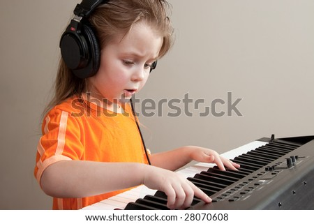 Nice girl learn playing piano - stock photo