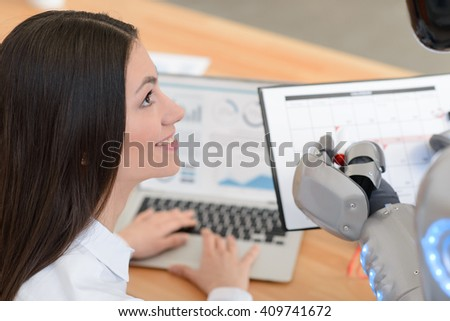 Nice girl looking at the robot