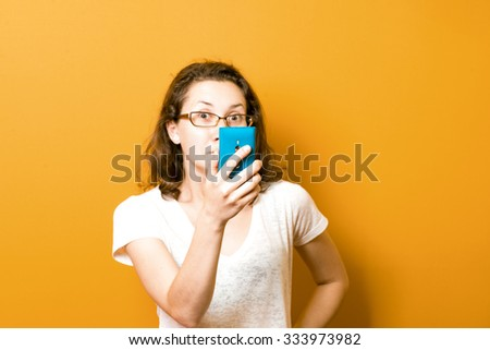 nice girl make a self-portrait with her smartphone