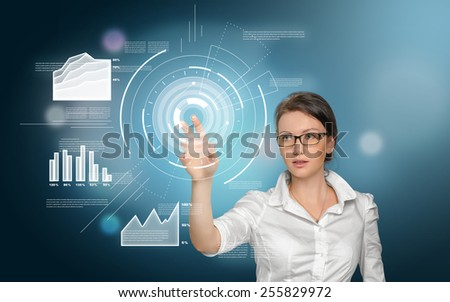 Nice girl presents her work on modern digital screen, blue background - stock photo
