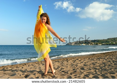 Nice girl relaxing on beach at morning