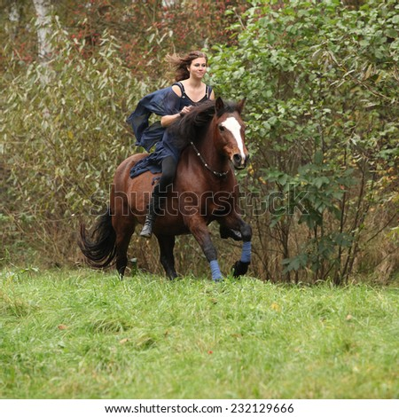 Nice girl riding a horse without bridle or saddle in autumn