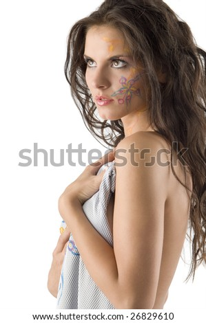 nice girl with a tattoo on her face covering herself with material - stock photo