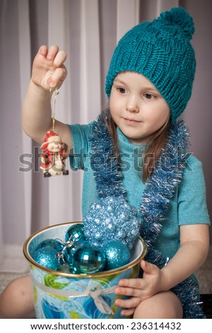nice girl with New Year's spheres  - stock photo