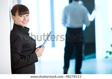 Nice girl with smile with blue folder - stock photo