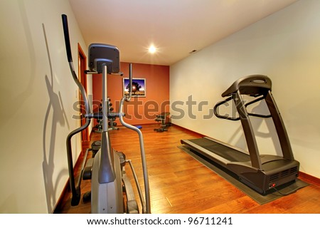 Nice home gym with sport equipment.