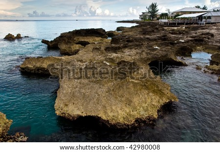 Nice house on rock at the bay of the sea - stock photo