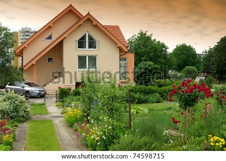 Nice house with the garden - stock photo