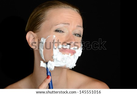 Nice humorous Image of a woman shaving - stock photo