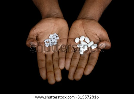 Nice Image Of a afro American Holding Pills - stock photo