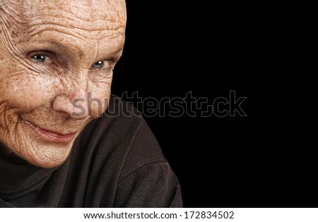 Nice Image of a peaceful Elderly Woman isolated on black - stock photo