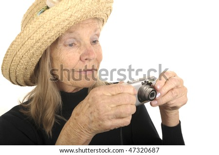 Nice Isolated Image of a Senior woman with Camera - stock photo