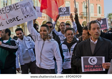 NICE - 15 JANUARY: tunisian manifestants rally the street of the city after the runaway of dictator Ben Ali from Tunisia yesterday evening,15 january 2010  in Nice France - stock photo