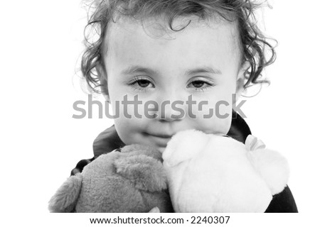 Nice kid with toy's. Shot in studio. - stock photo