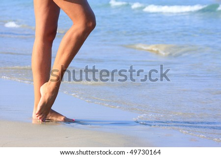 stock photo nice legs of a pretty girl walking in water 49730164