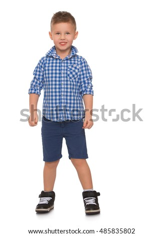 Nice little boy in shirt and shorts looking straight at the camera - Isolated on white background