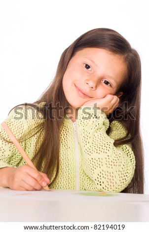 nice little girl drawing at the table - stock photo
